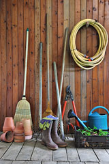 storage shed wall with gardening tools and accessories